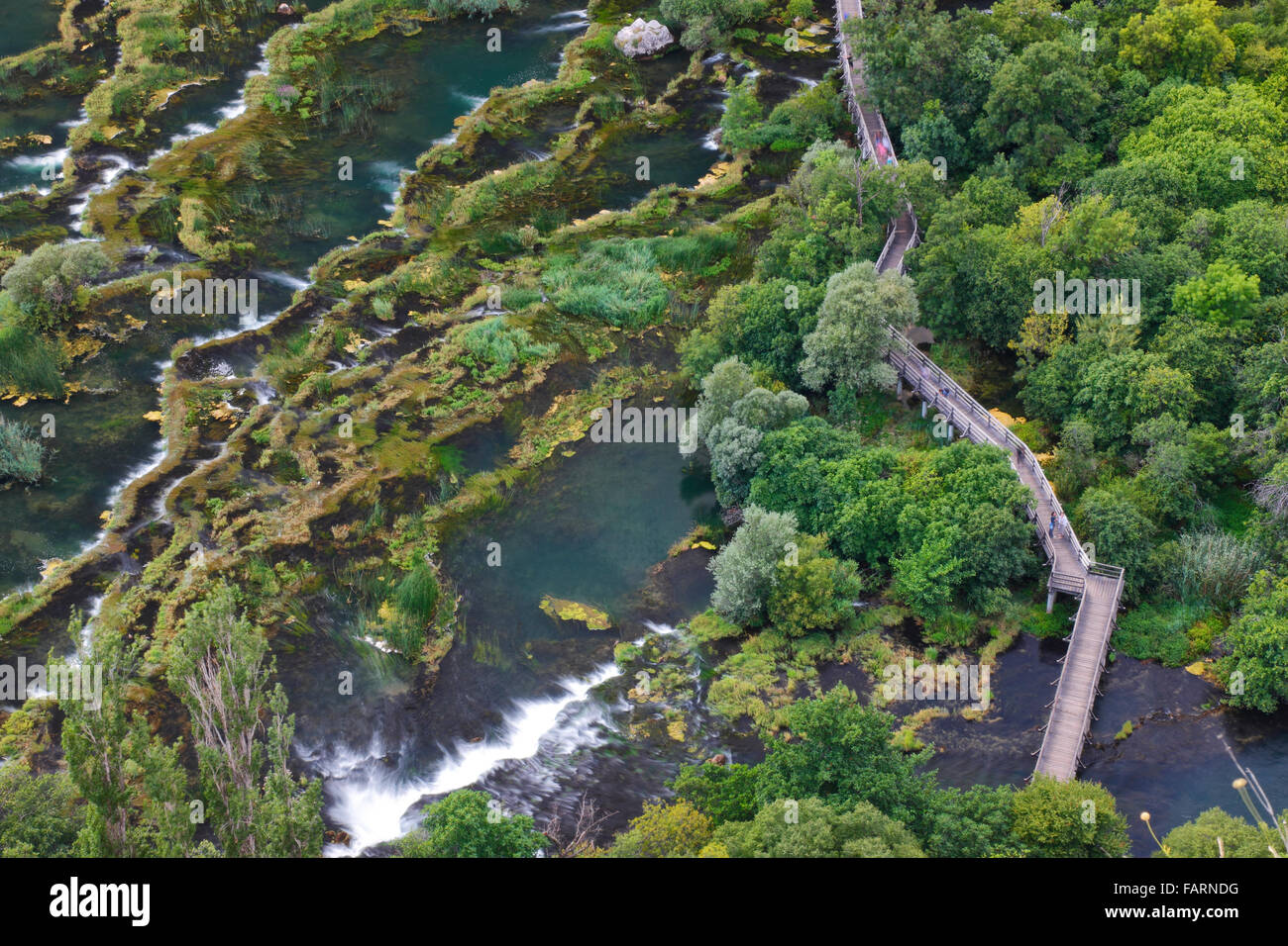 Wooden bridge over river Krka in National park Krka, Croatia Stock Photo