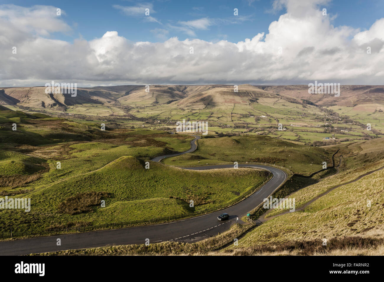 The road to the village of Barber Booth from a position on the footpath up to Mam Tor - Stock Image