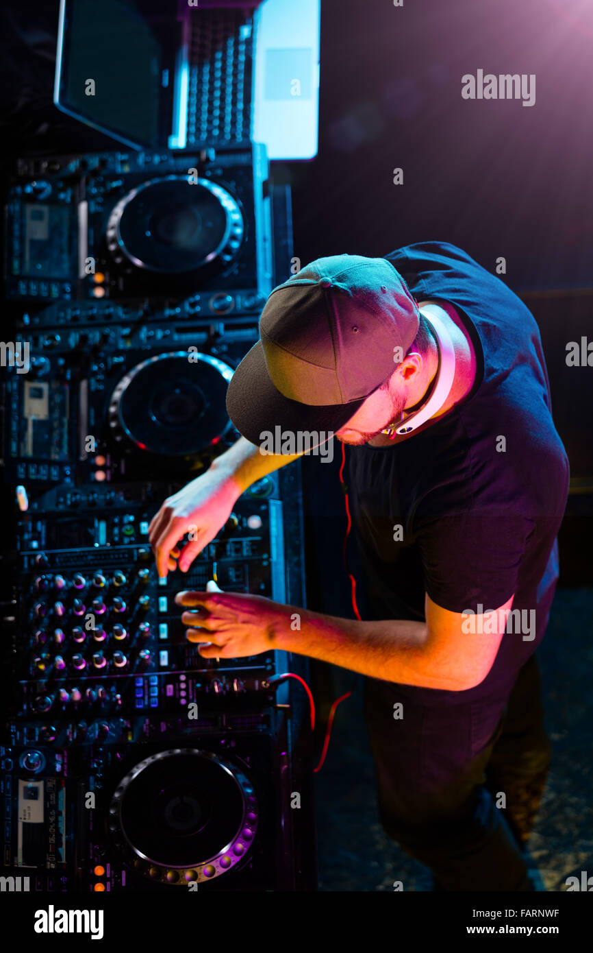 DJ man mixing electronic music on stage. Shot from aerial view - Stock Image