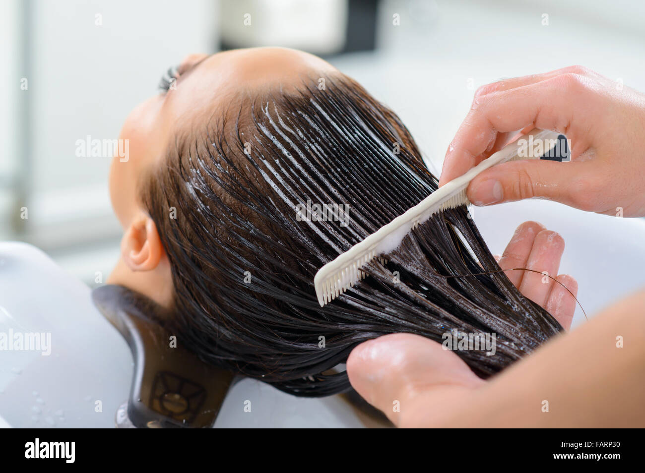 Clients hair is being renovated. - Stock Image