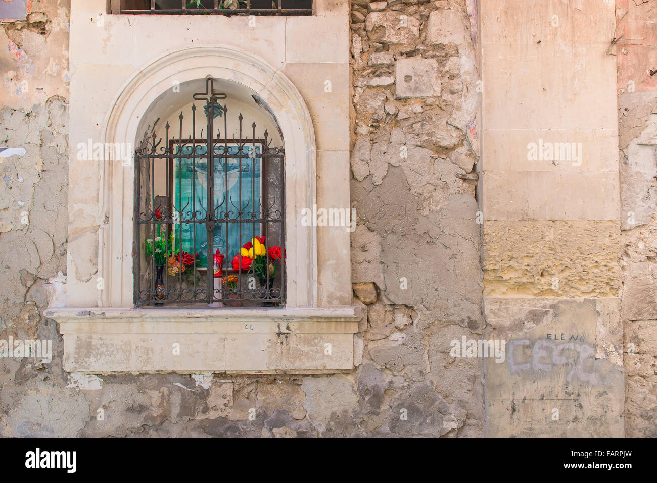 Shrine wall italy, view of a neighbourhood shrine set into an old wall in the Old Town (Centro Storico) area of - Stock Image