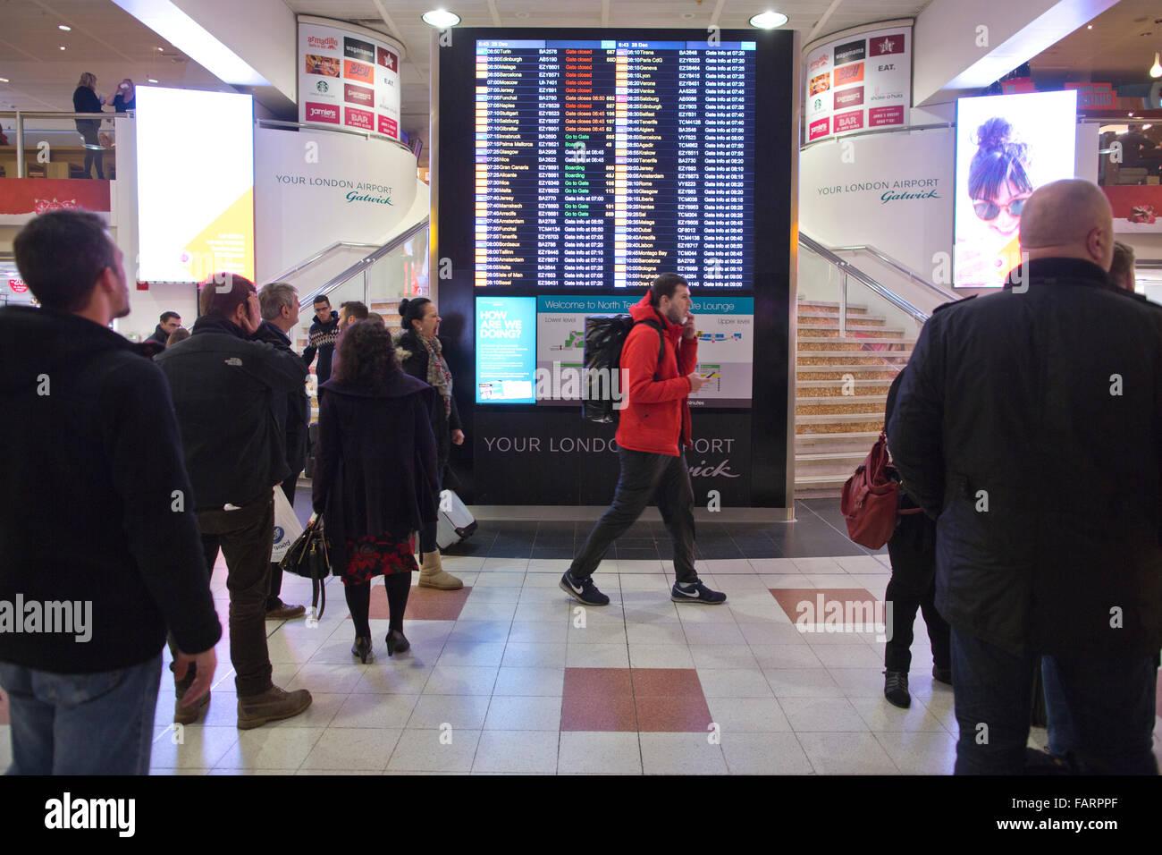 Departures flight information screen, Gatwick North terminal, England, United Kingdom - Stock Image