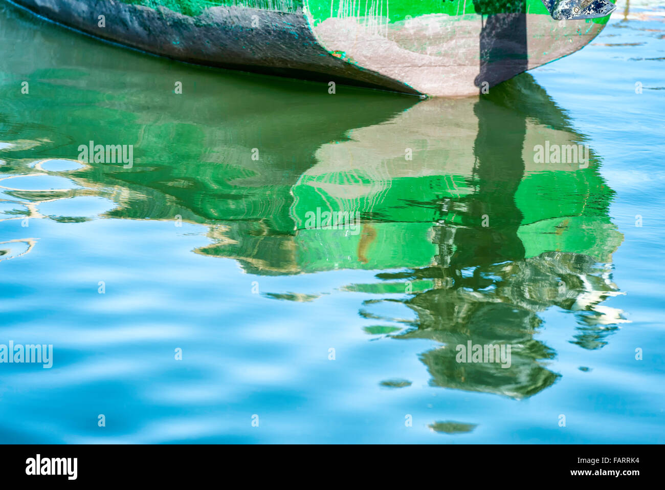 Boat with reflection in water. Stock Photo