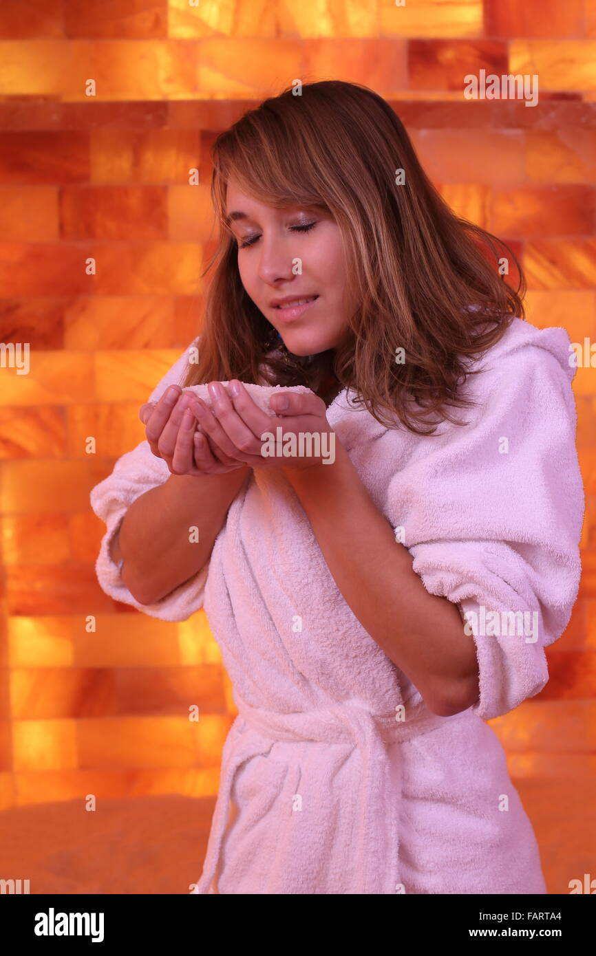 A Woman in salarium deep breath with salt - Stock Image