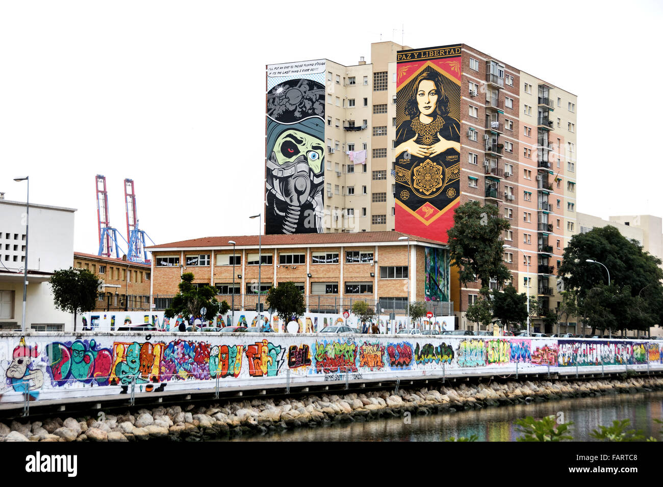 Malaga Spanish Spain Andalusia ( Mural paintings of D Face (l) and Obey Shepard Fairey (r) Soho art district ) - Stock Image