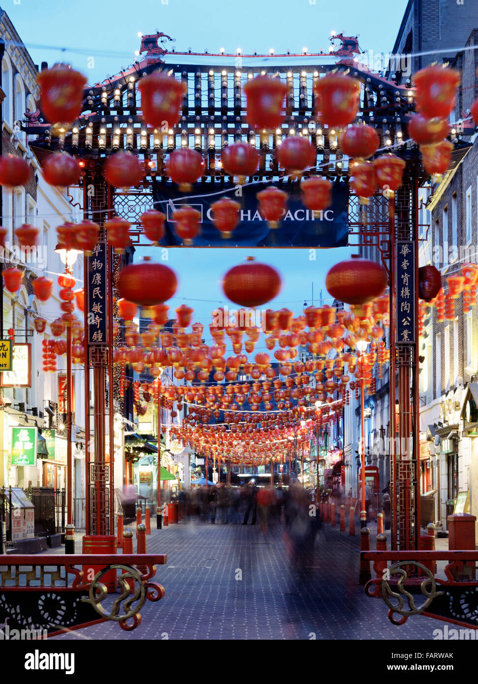 CHINATOWN, Gerrard Street, London. General view of china town at dusk showing red lanterns and entrance gateway. - Stock Image