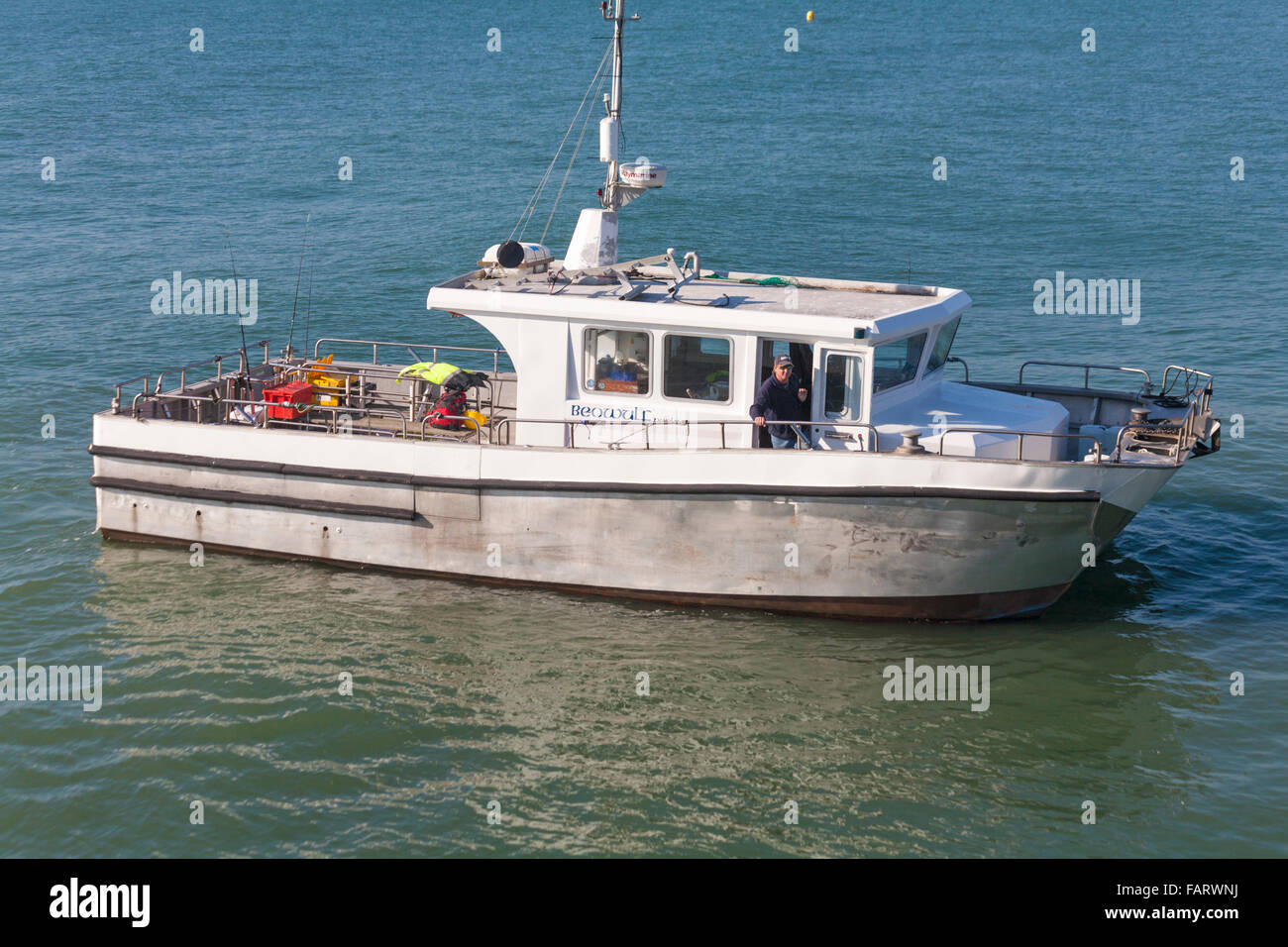 Beowulf Poole, a Cat Fish 38 aluminium catamaran vessel that offers fishing charters, in Bournemouth Bay in October - Stock Image