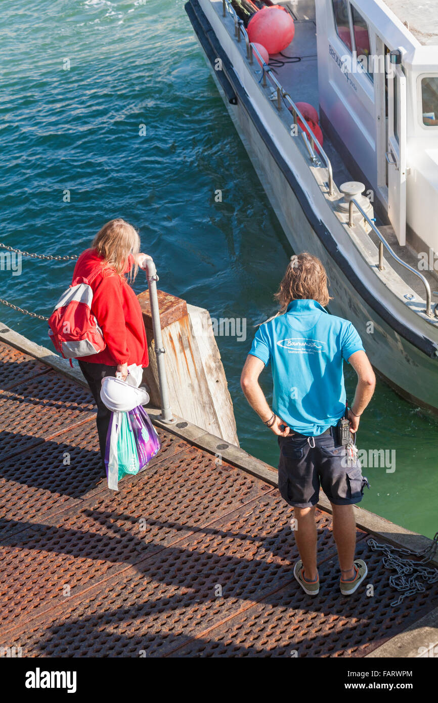 Waiting on Bournemouth pier to board the Beowulf Poole, a Cat Fish 38 aluminium catamaran vessel that offers fishing - Stock Image