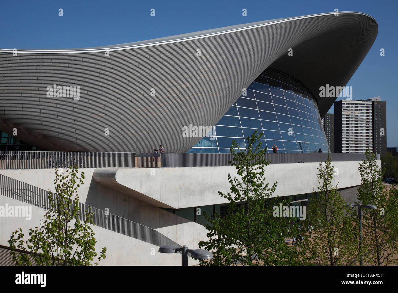 Swooping roof of the aquatics centre. - Stock Image