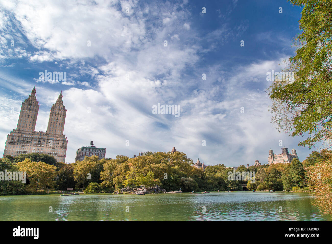 The Lake in Central Park with a view of the Upper West Side of Manhattan including the San Remo Apartments (1929 - Stock Image