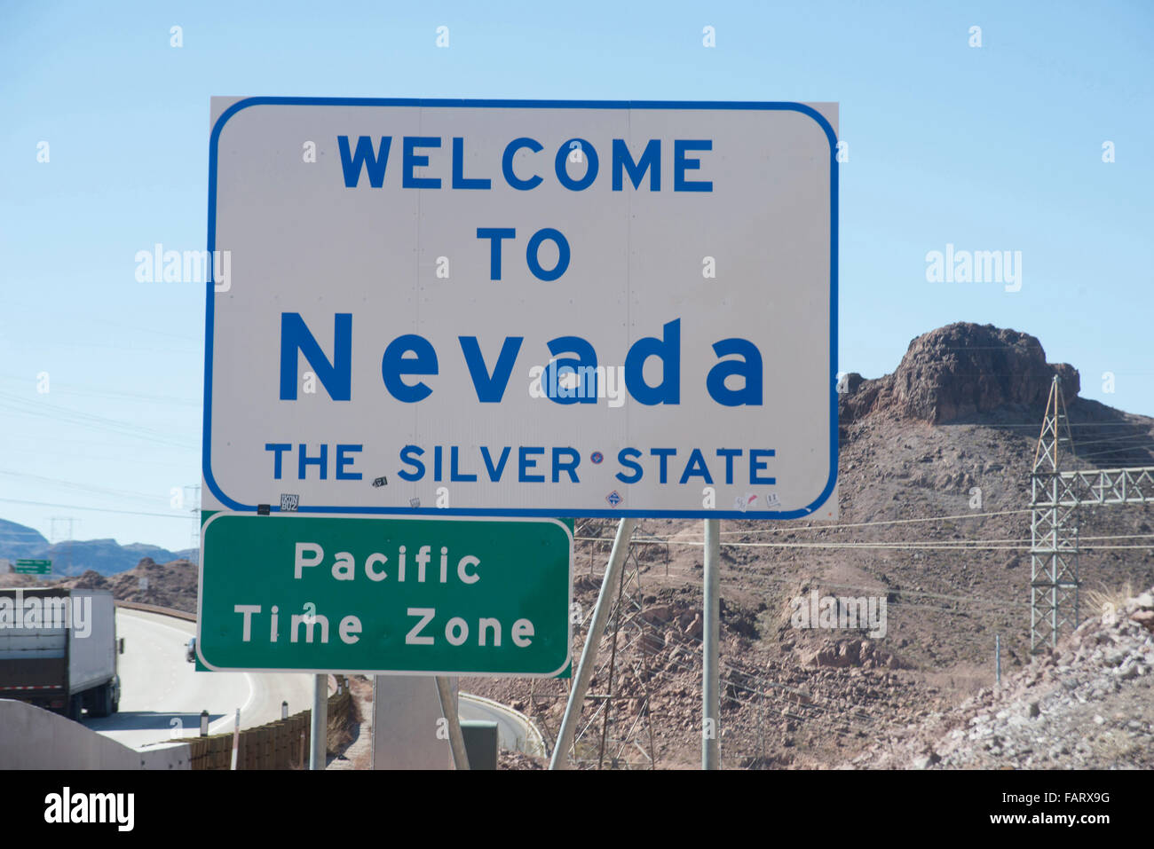 Welcome To Nevada Road Sign Stock Image - Image of rock