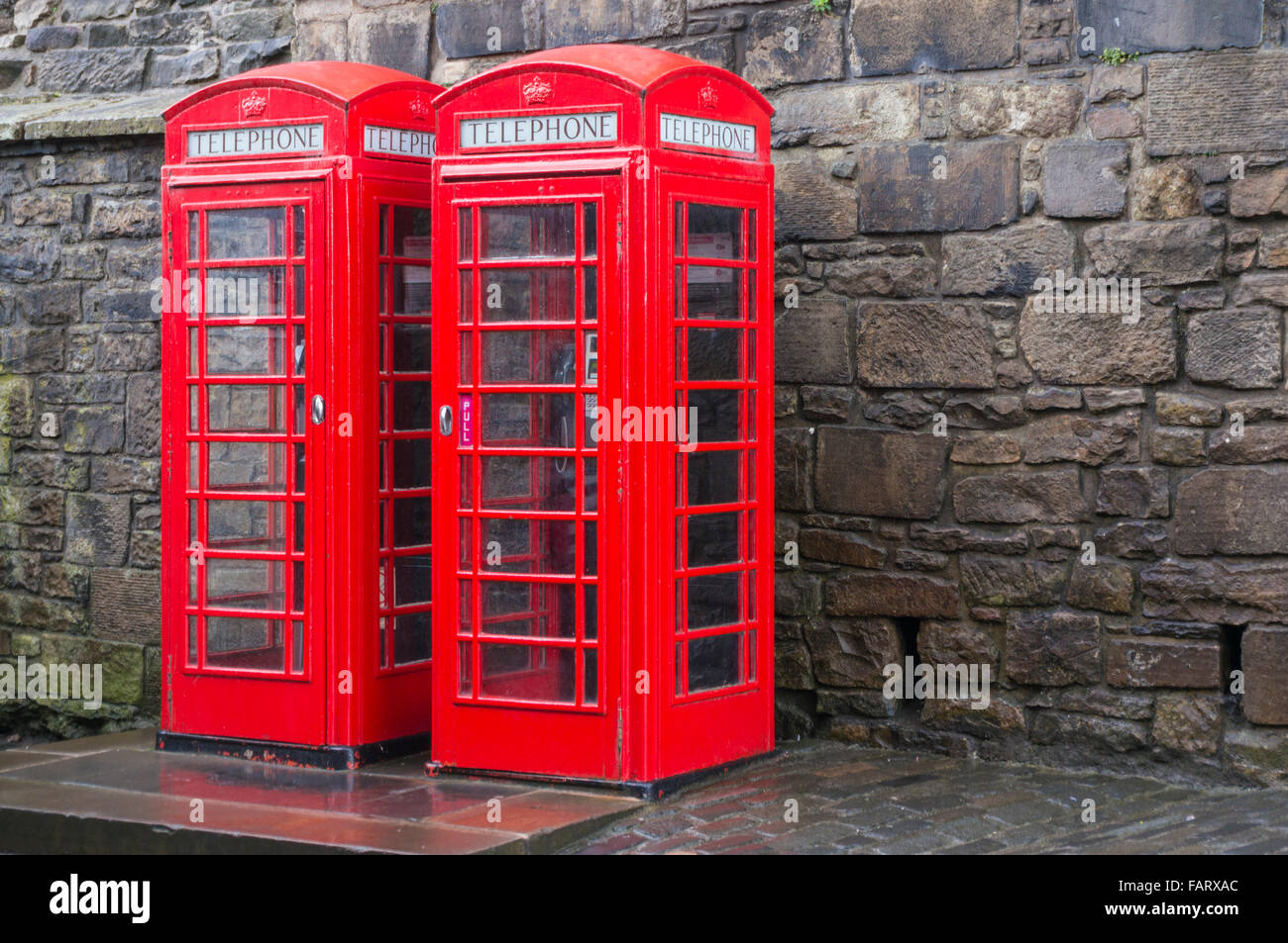 two traditional red telephone boxes red phone box uk - Stock Image
