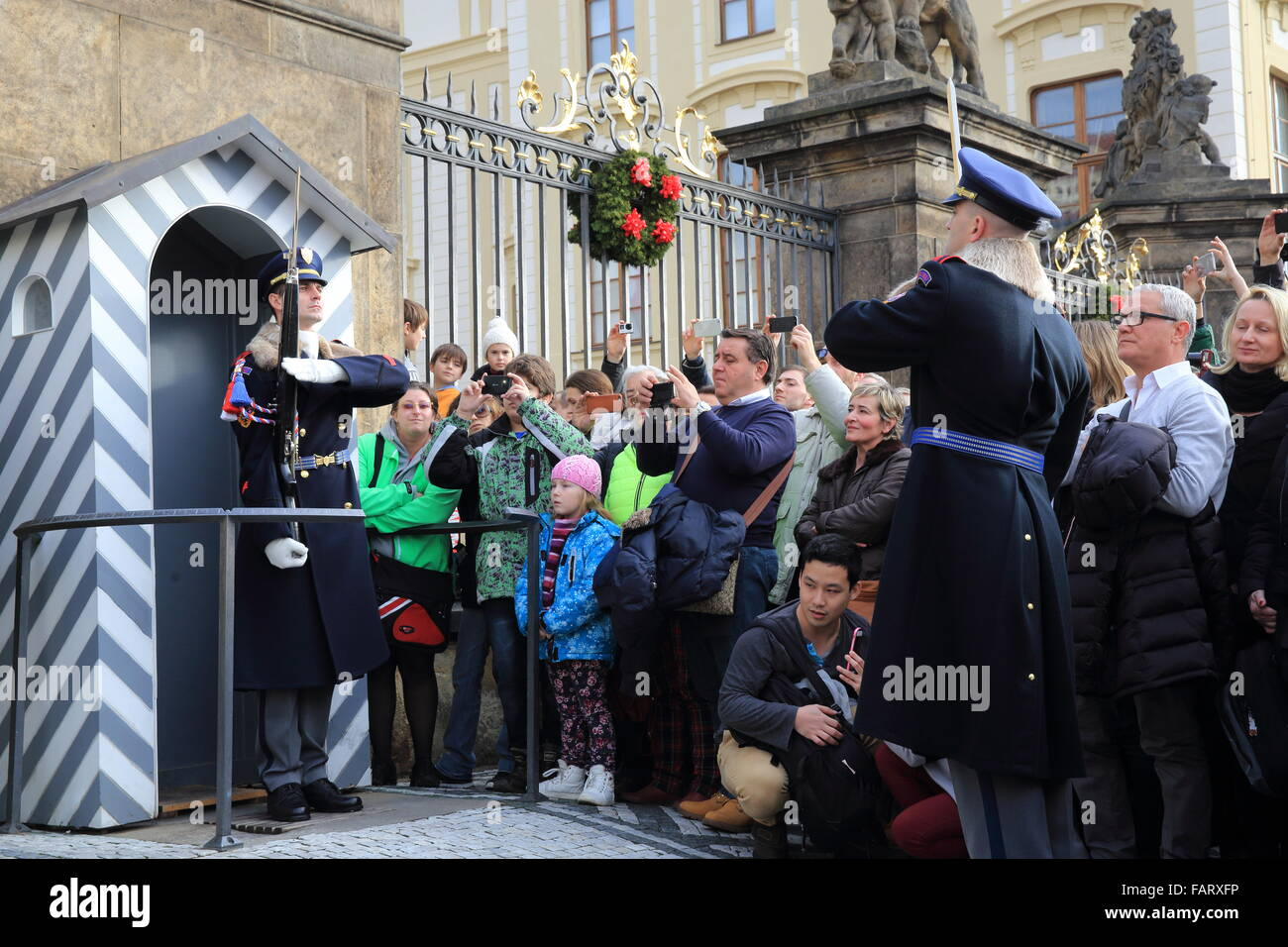 The Changing of the Guard midday ceremony at the entrance to Prague Castle, in wintertime, Czech Republic, Europe - Stock Image