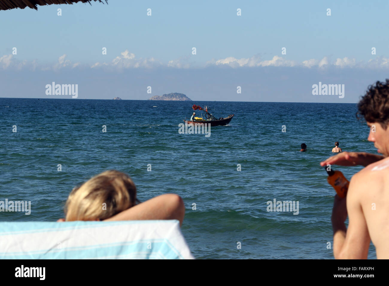 South China Sea traditional boat floating beach - Stock Image