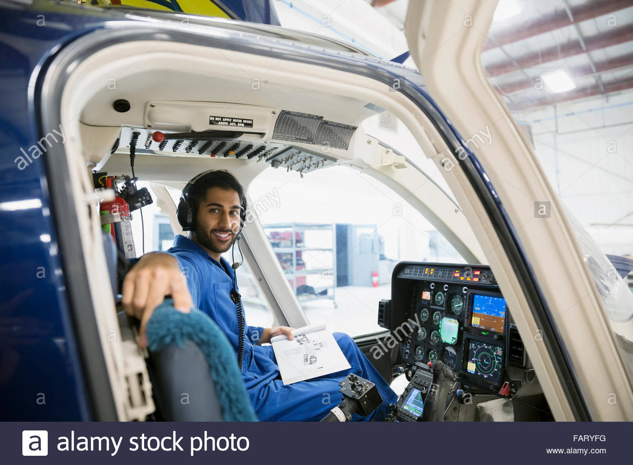 Portrait confident mechanic in helicopter cockpit - Stock Image
