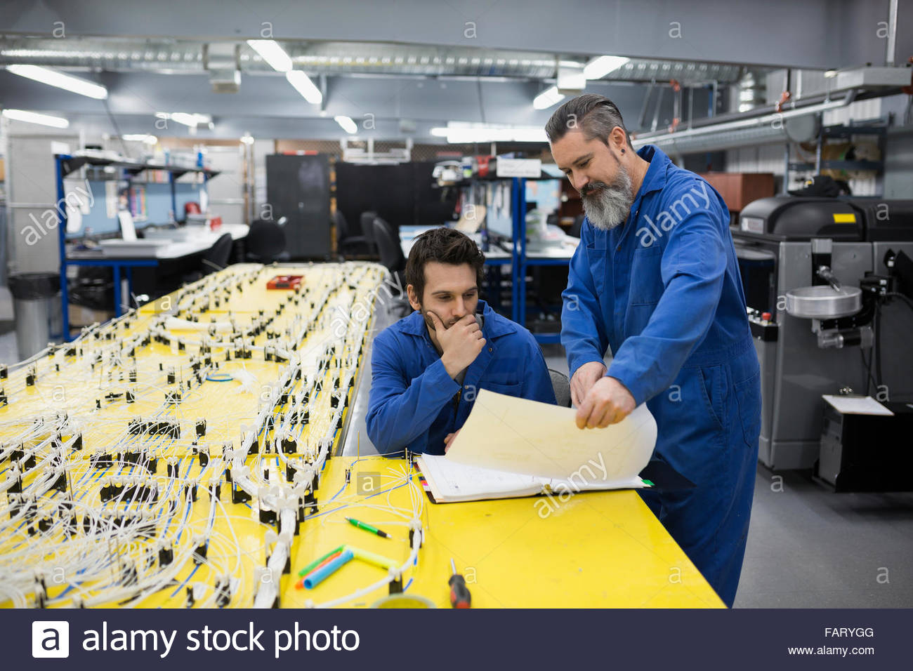 Wiring Harness Stock Photos Images Alamy Testing Equipment Helicopter Technicians Reviewing Blueprints At Image