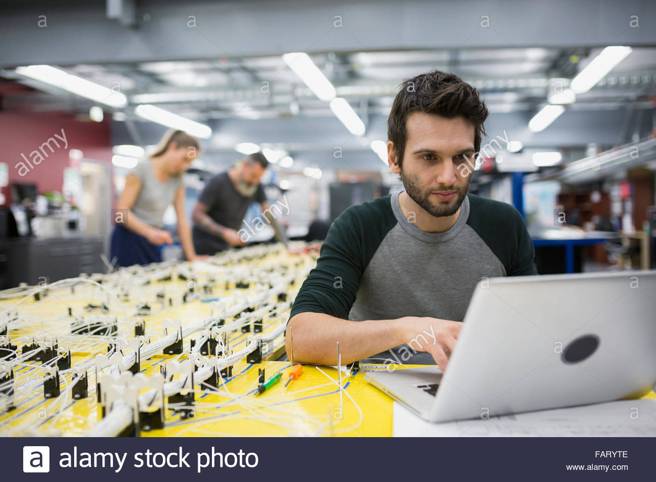 Wiring Harness Jobs Usa Stock Photos Images Alamy Helicopter Technician Using Laptop At Image