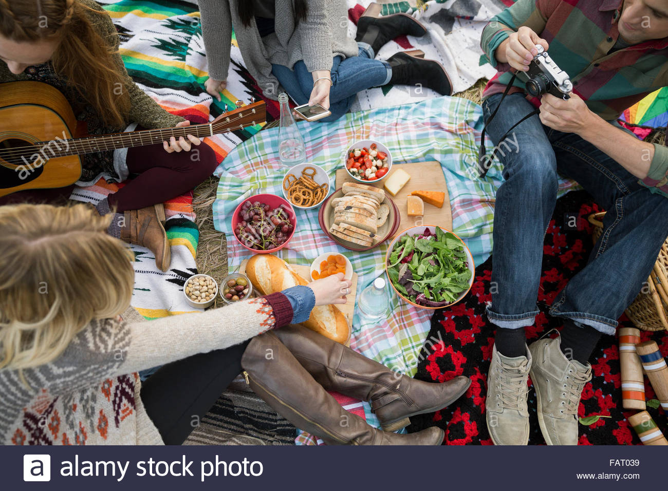 Overhead view friends enjoying picnic - Stock Image