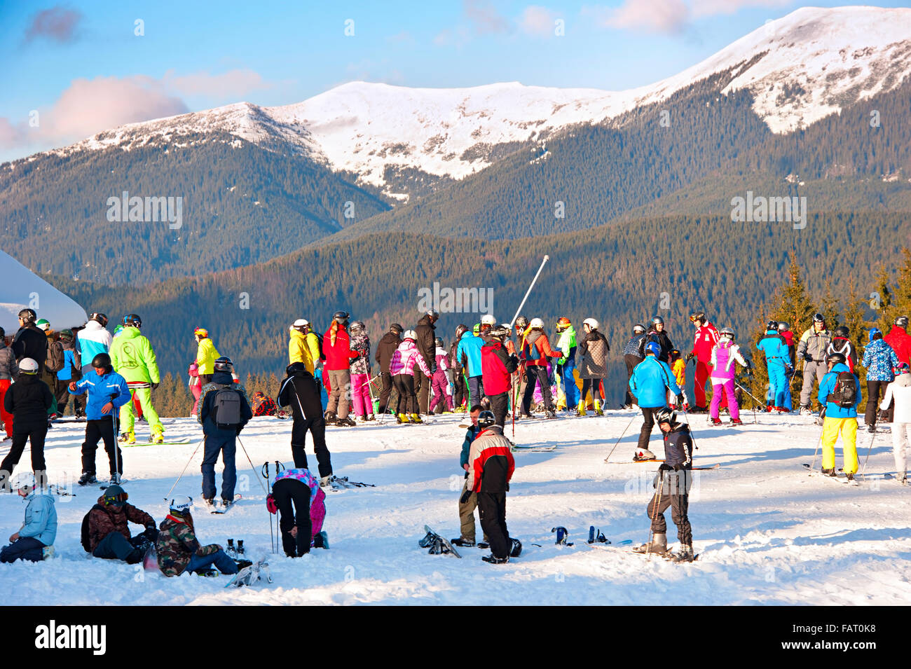 Lots of people at top of a slope in Bukovel. - Stock Image