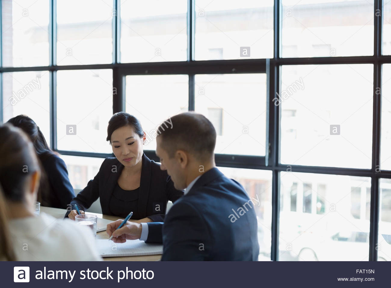 Business people planning in conference room meeting - Stock Image