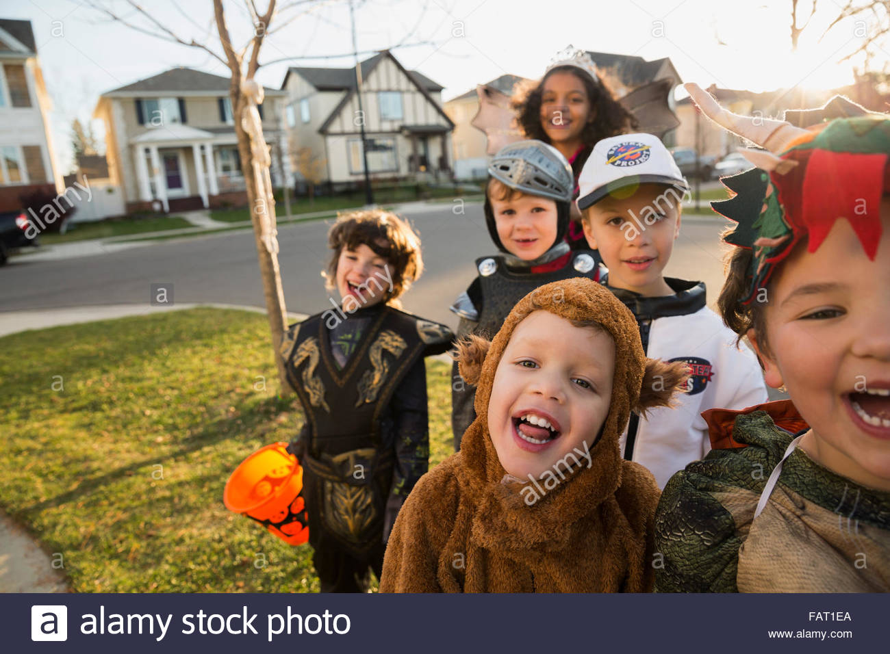Portrait enthusiastic kids in Halloween costumes - Stock Image