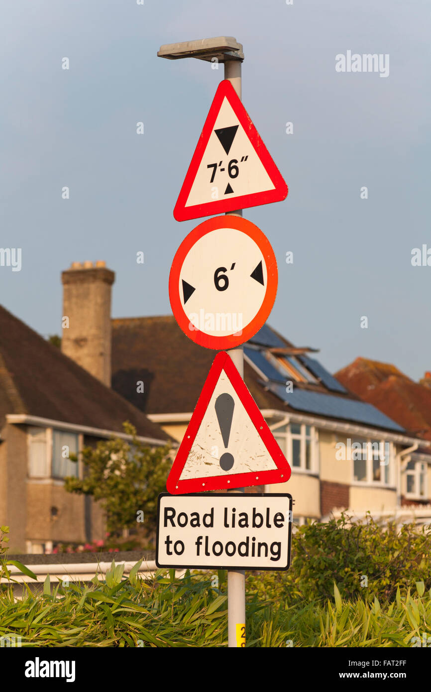 Road signs in Poole showing height and width restrictions and road liable to flooding Stock Photo