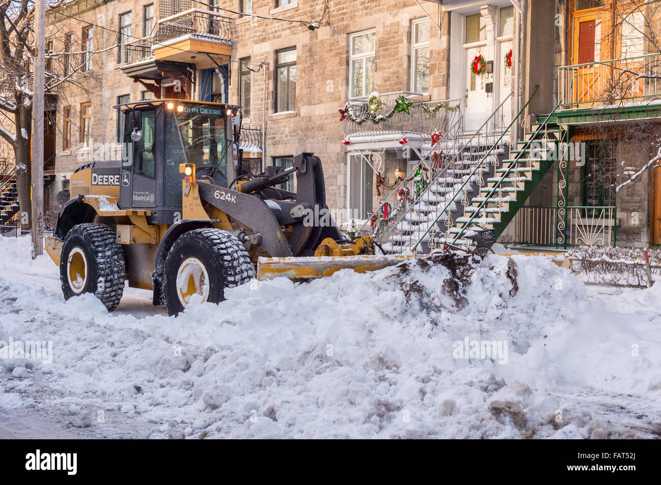 Montreal, Canada. 4rd January 2016. Snowplow removes snow during snow storm - Stock Image