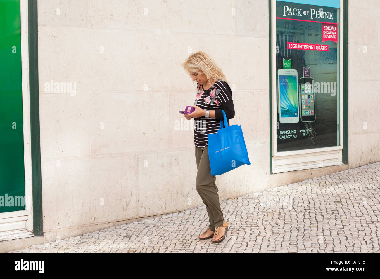 Woman looking at cell phone. - Stock Image