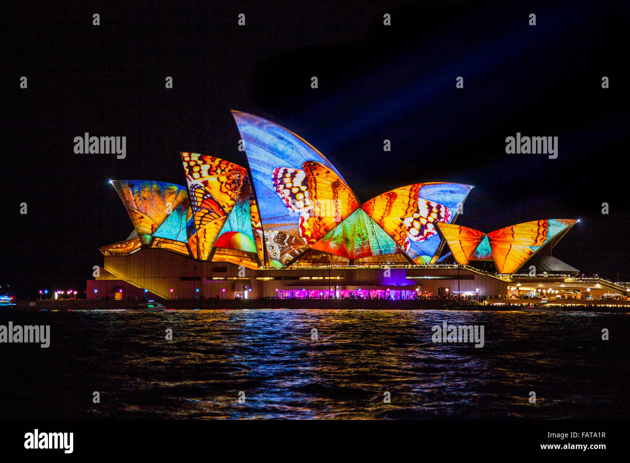 Lighting of the sails of the Sydney Opera House during Vivid 2014 by the projection art team 59 Productions - Stock Image