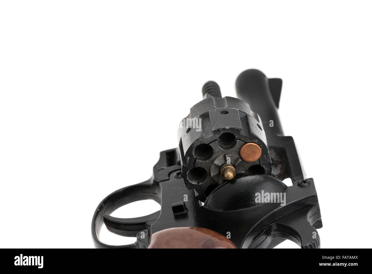 Loaded gun with a single bullet - Russian roulette concept - white background - Stock Image