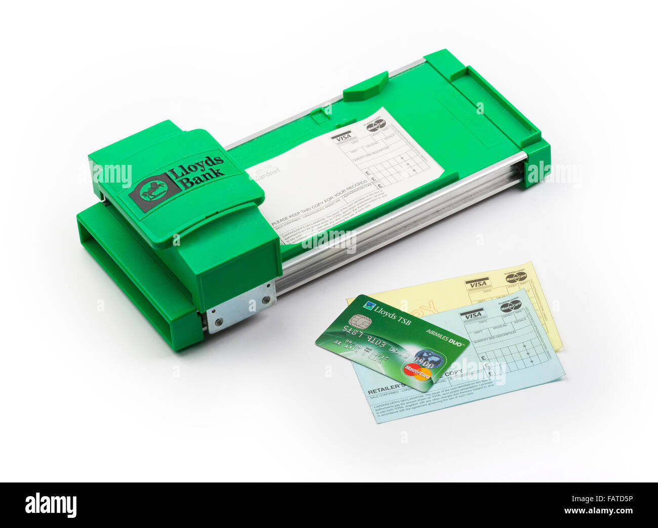 Manually operated credit card imprinter machine - Stock Image