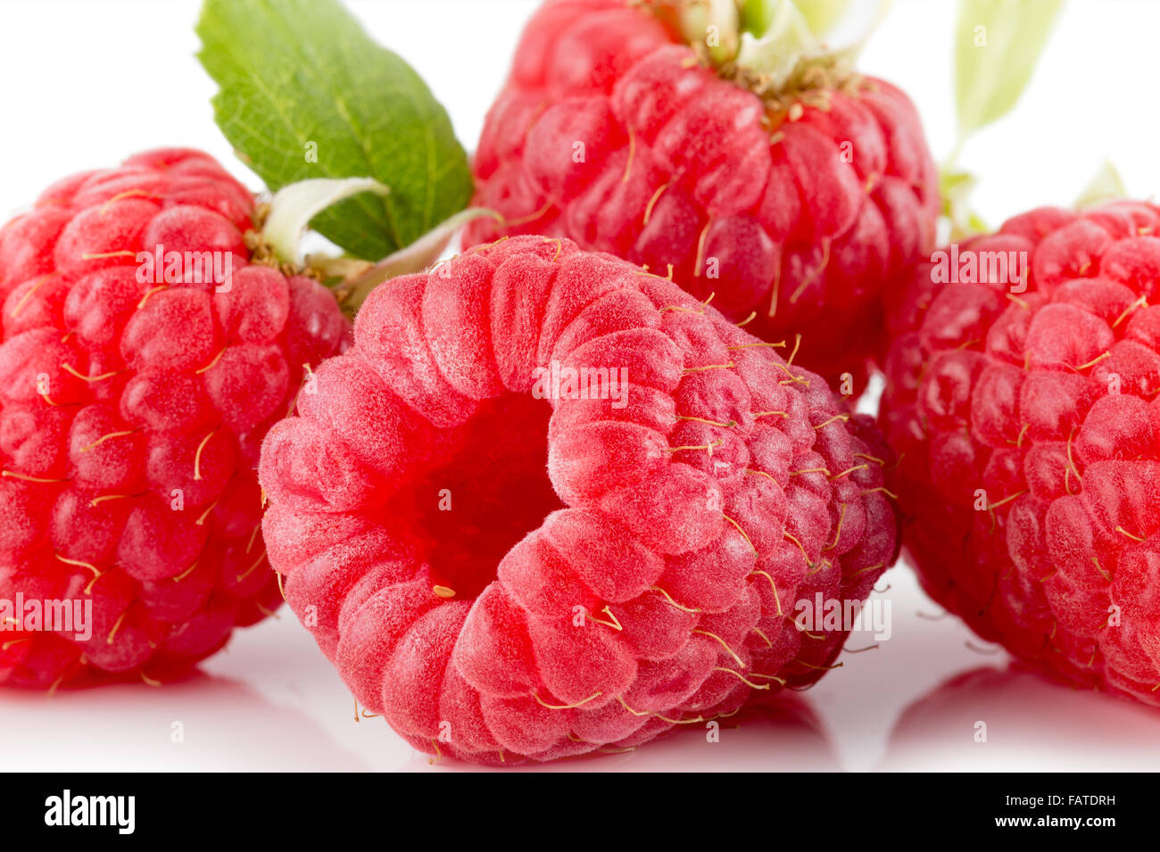 raspberries isolated on the white background. - Stock Image