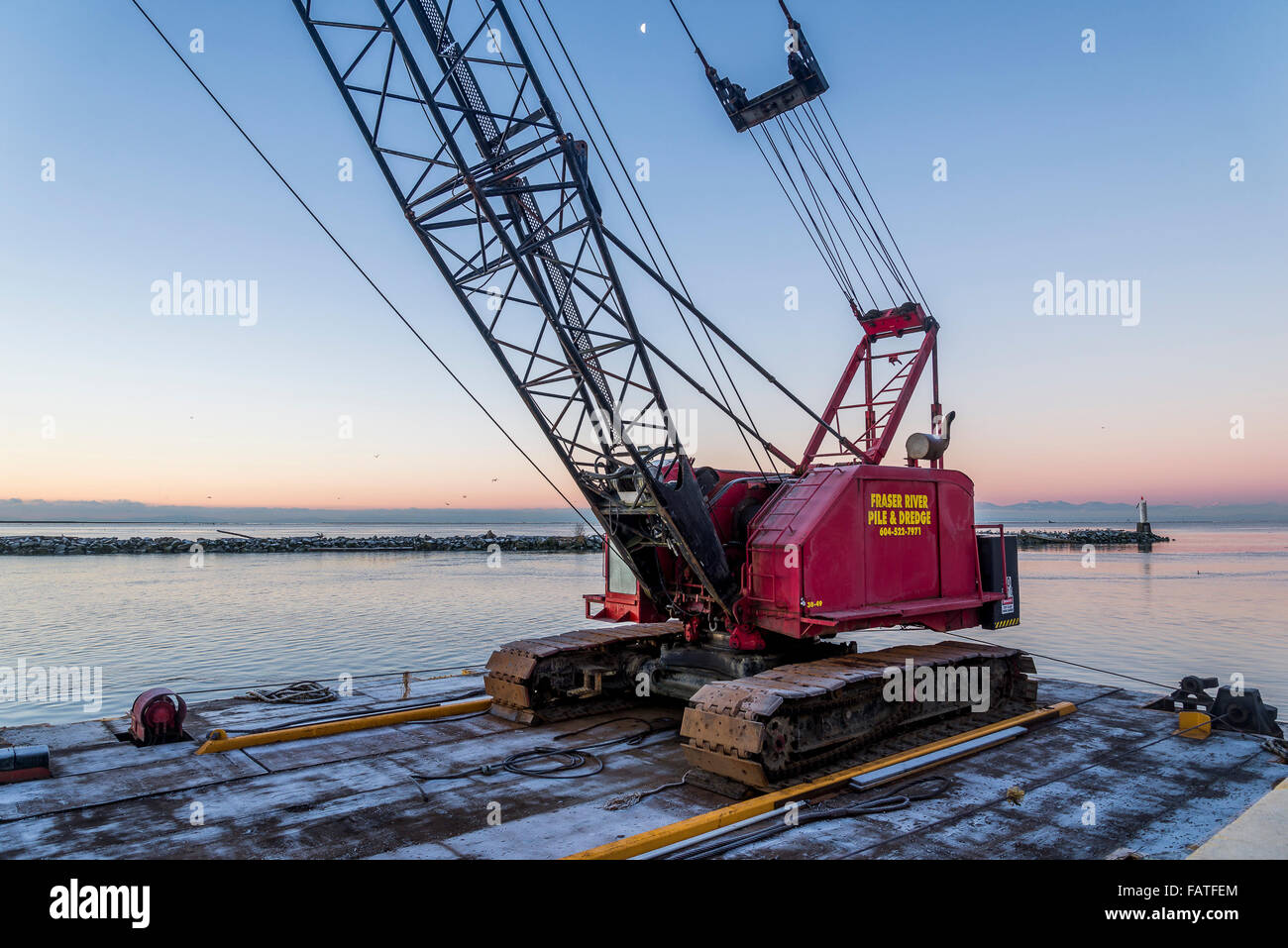 Fraser River Pile and Dredge, pile driving crane on barge, Steveston, Richmond, British Columbia, Canada, - Stock Image