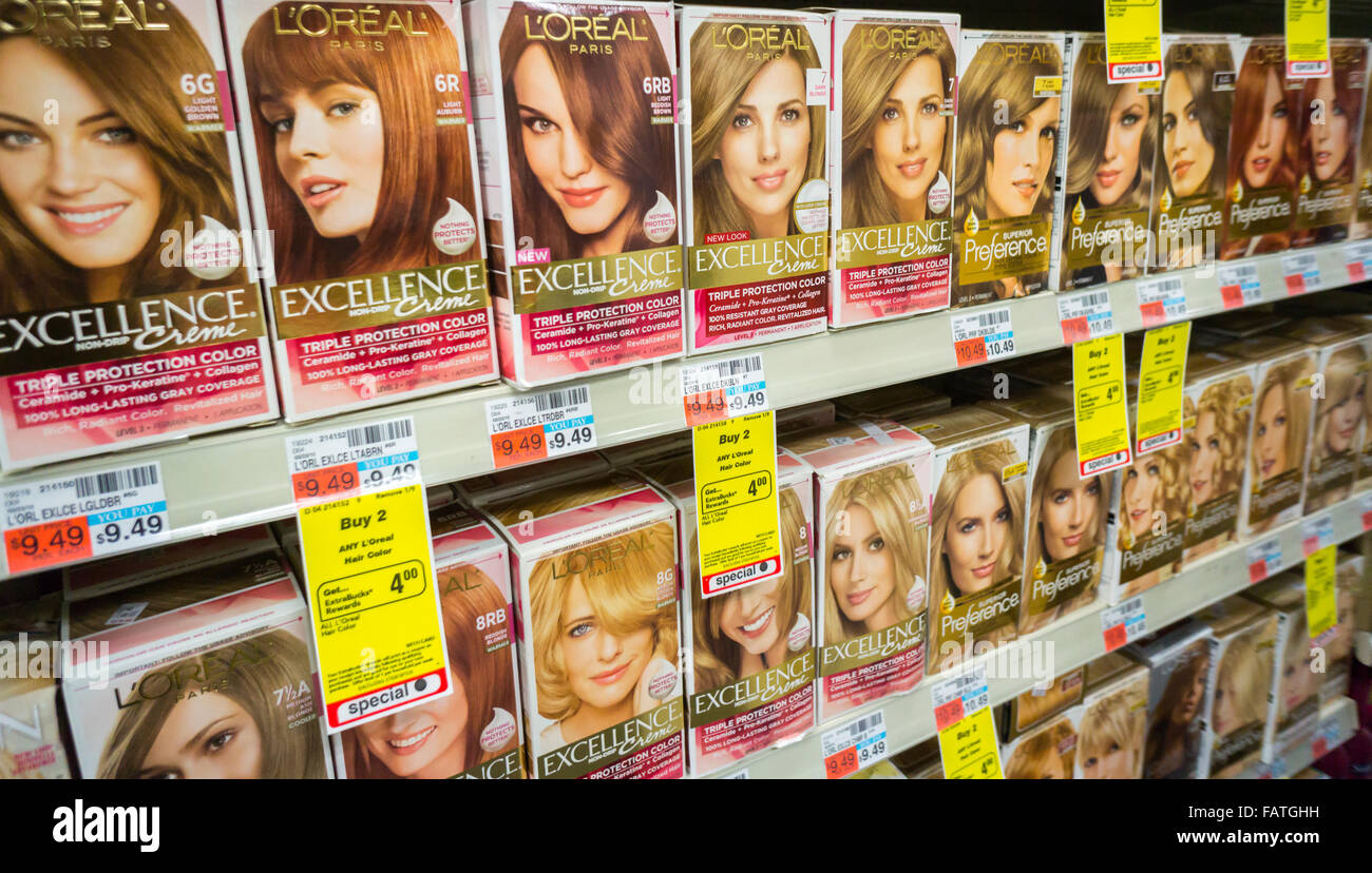 A Collection Of Loreal Brand Hair Color Products On A Shelf In A