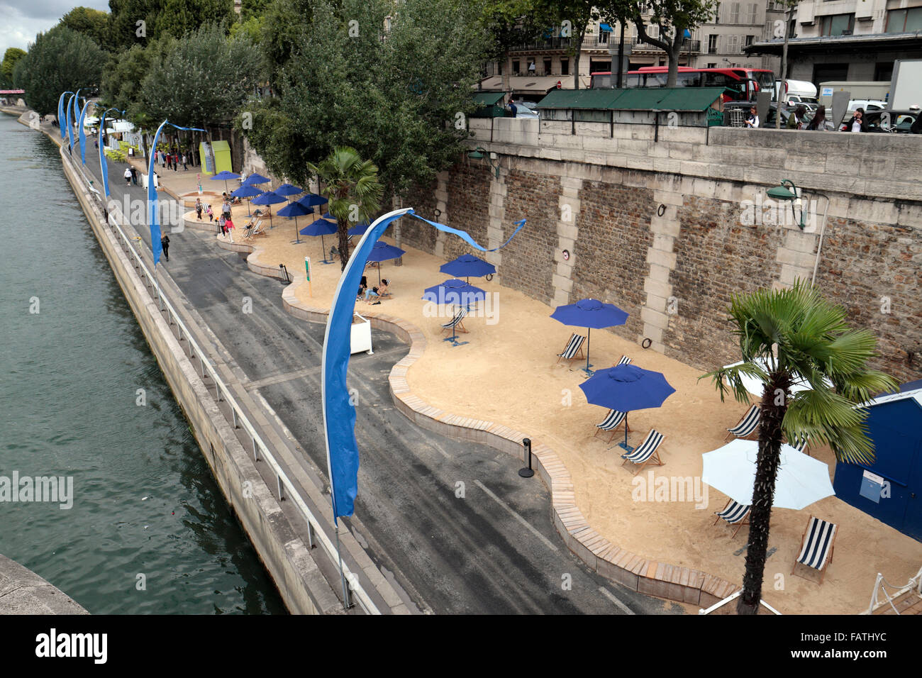 The Paris-Plages ('Paris Beaches') beach close to Pont Neuf in Paris, France. (on a very windy overcast - Stock Image