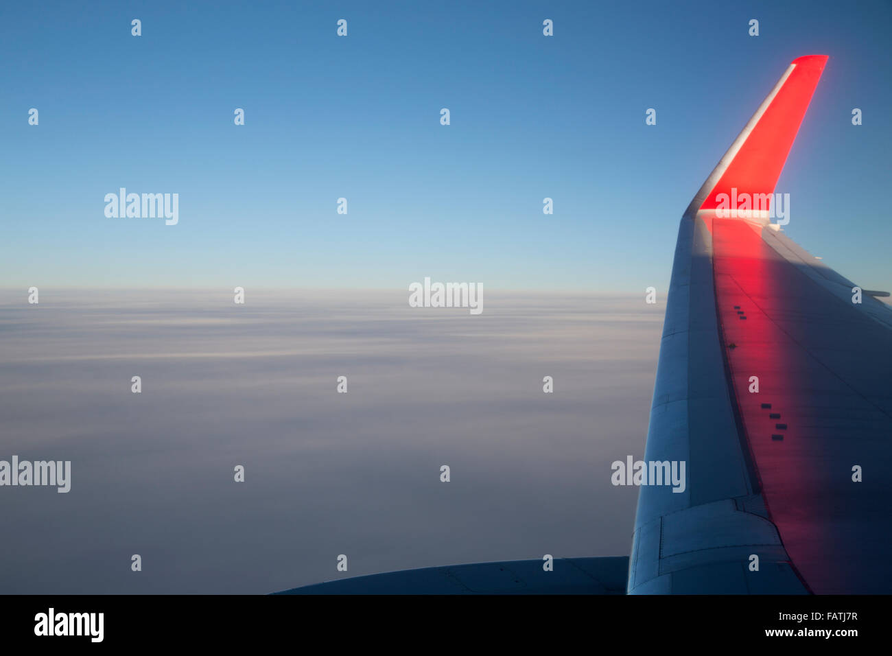 View from an aeroplane window, looking over the wing and winglet. - Stock Image
