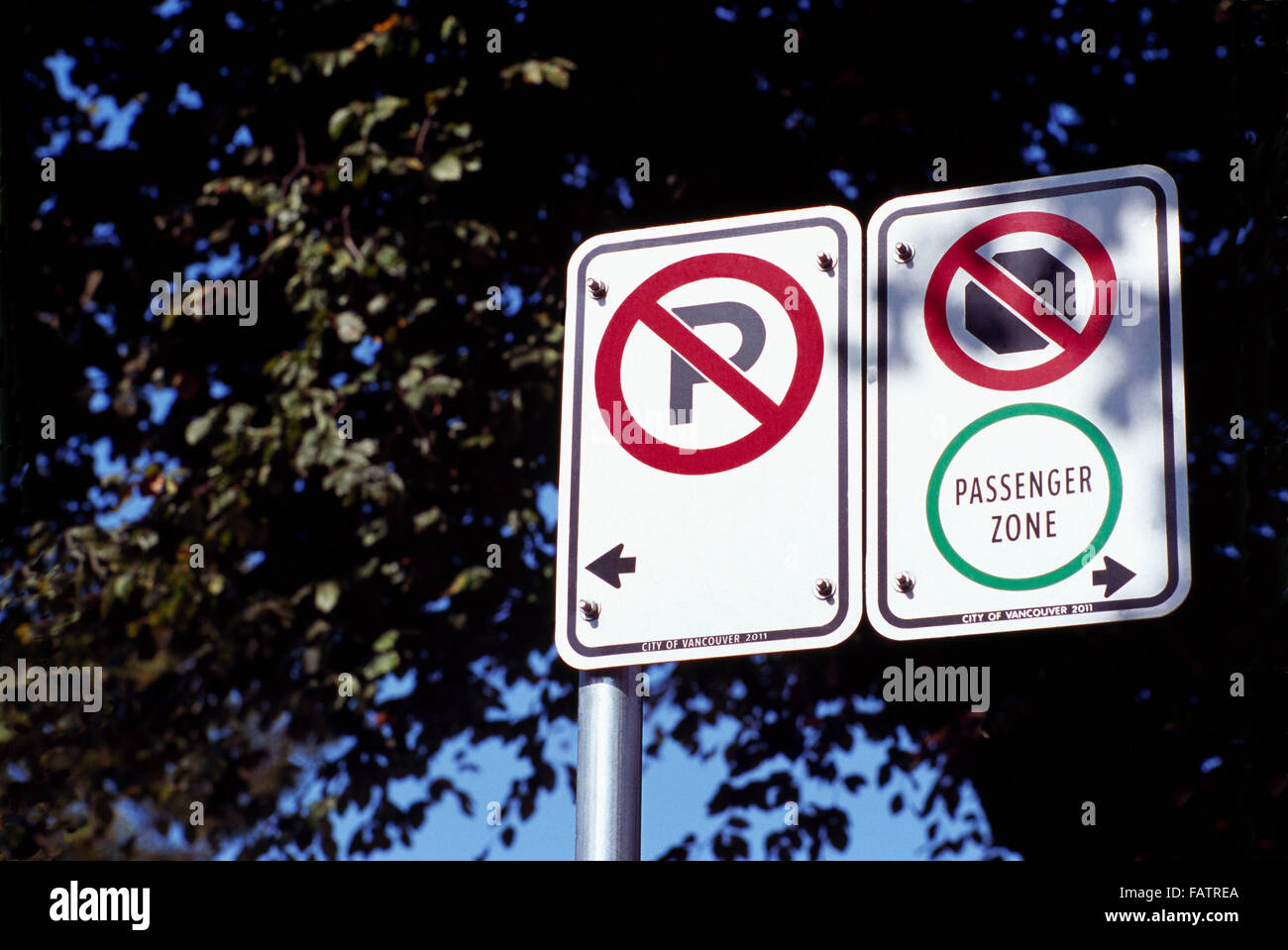 City Bylaw Sign - No Parking, No Stopping, Passenger Zone - Stock Image