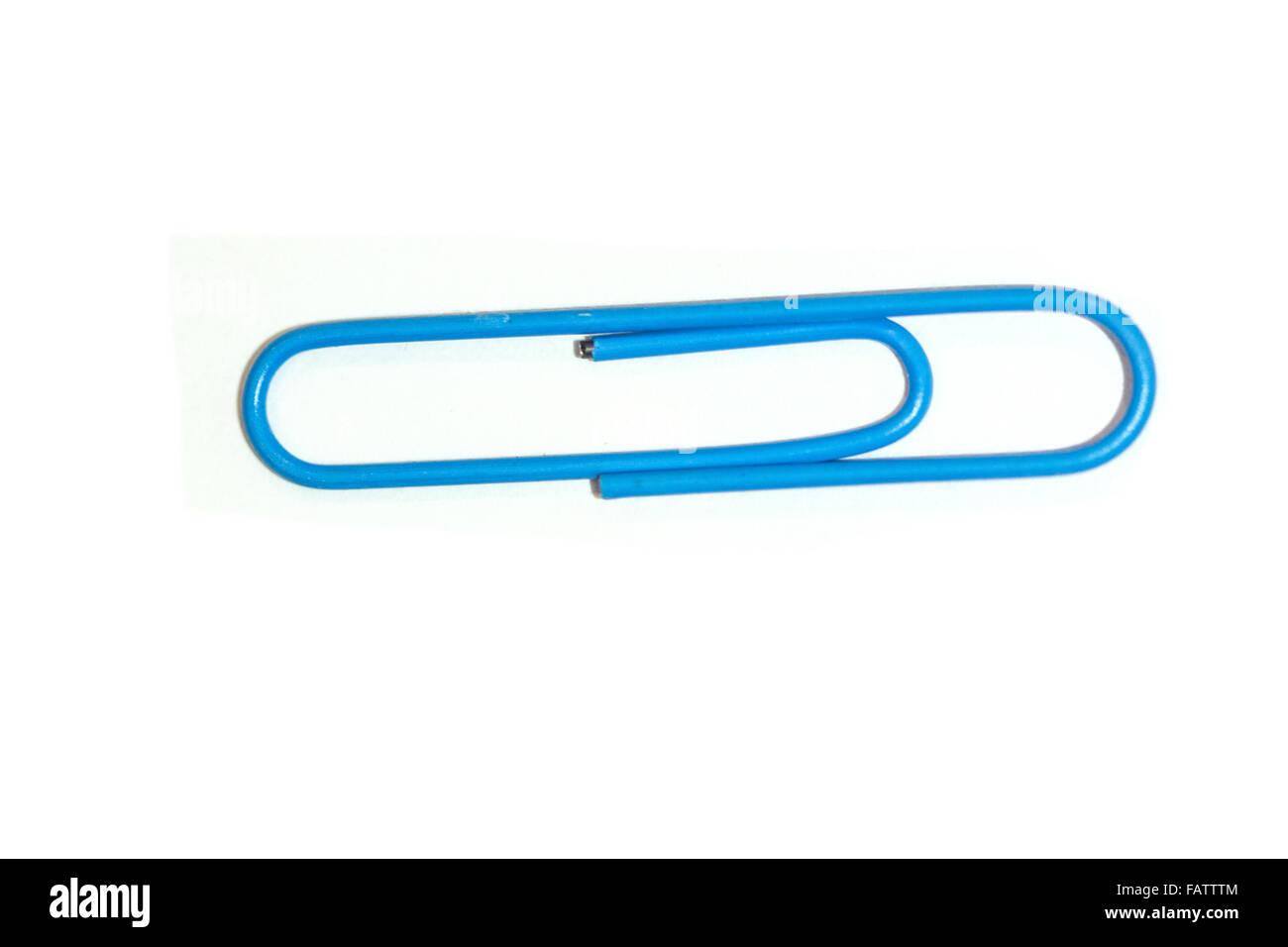 A blue paper clip - Stock Image