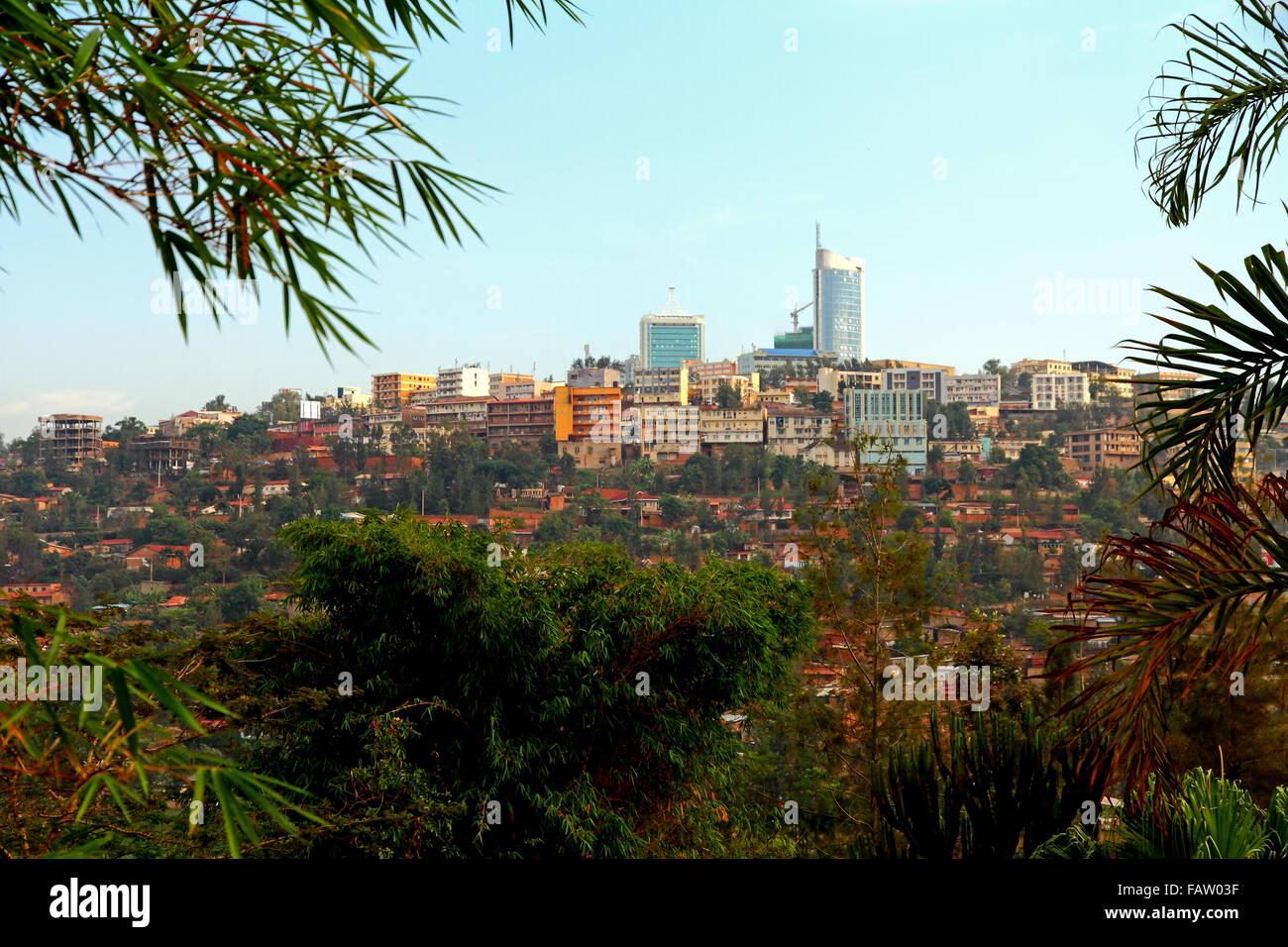 Downtown Kigali, Rwanda framed by trees - Stock Image