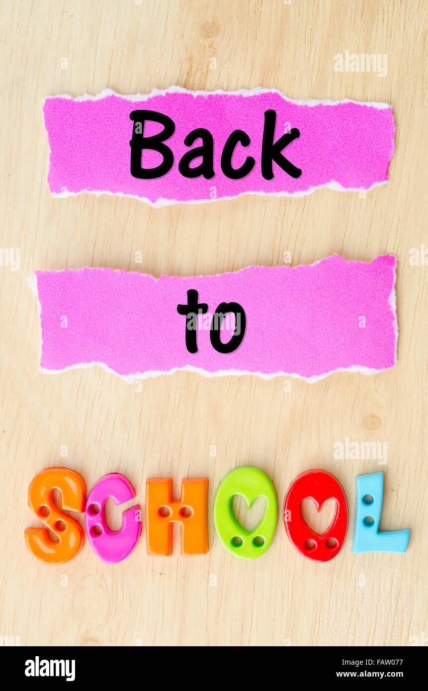 Back to school wording on wooden background. - Stock Image