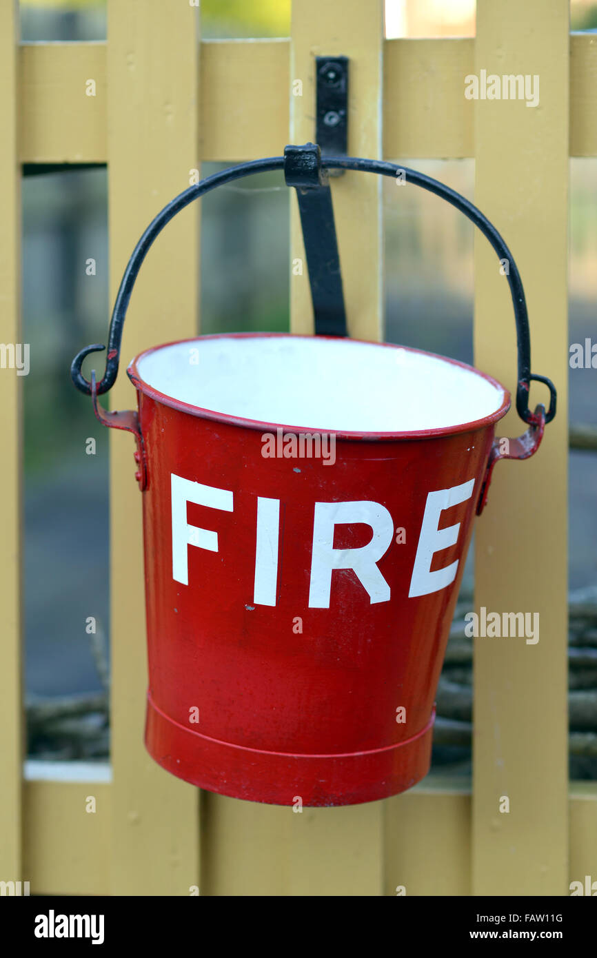 Old fire bucket at steam railway station - Stock Image