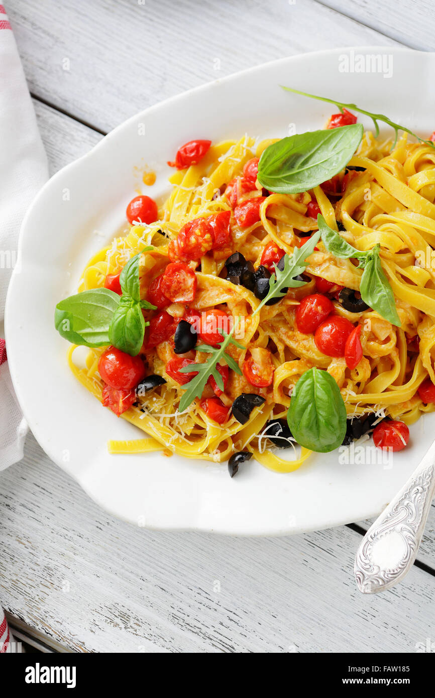 pasta with tomato sauce on white plate, food - Stock Image