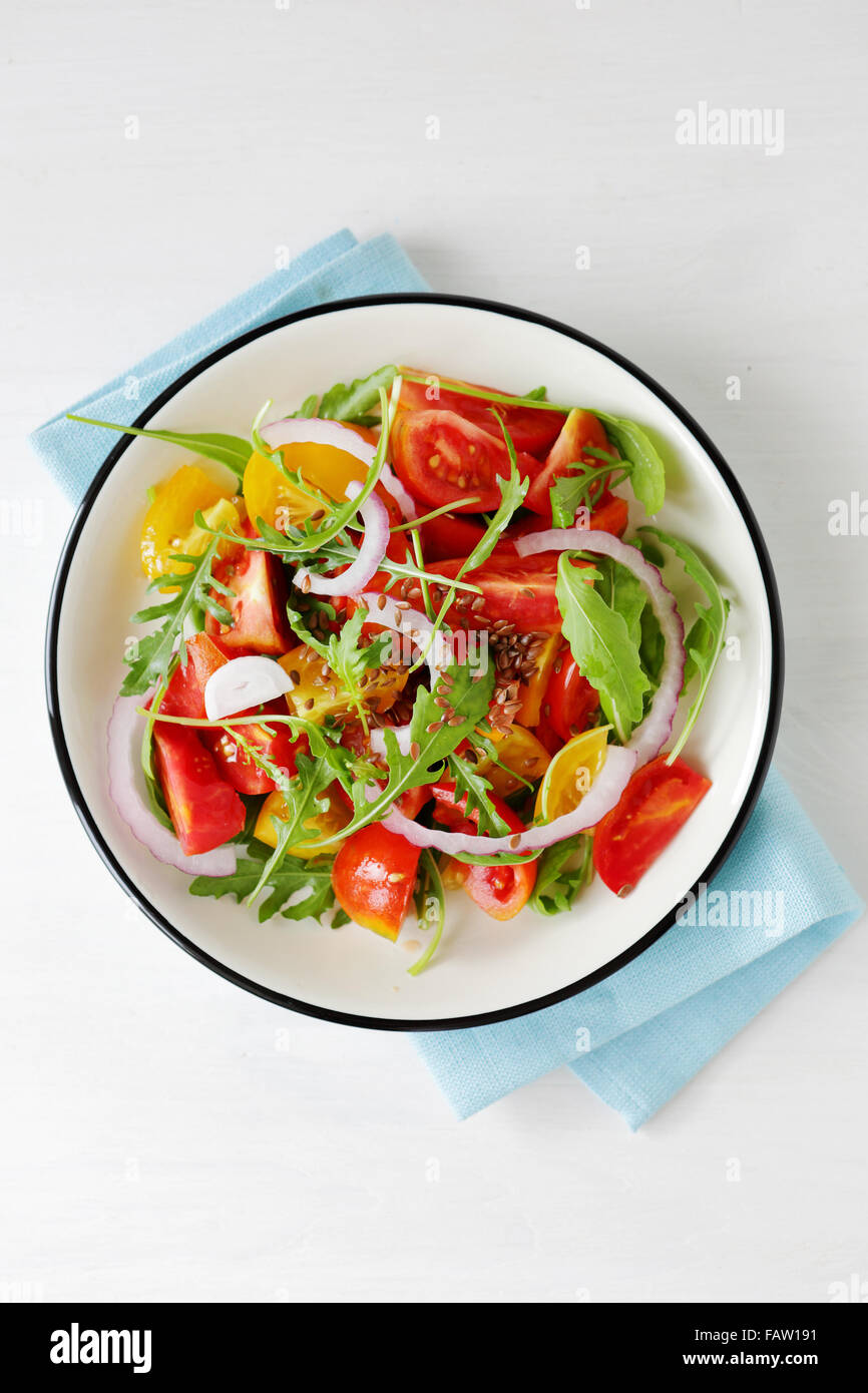 light tomato salad on plate, top view - Stock Image