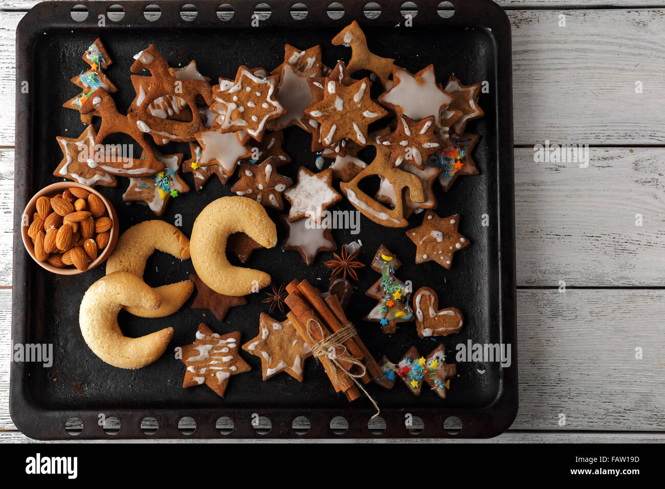 sweet gingerbread cookies for christmas on tray - Stock Image