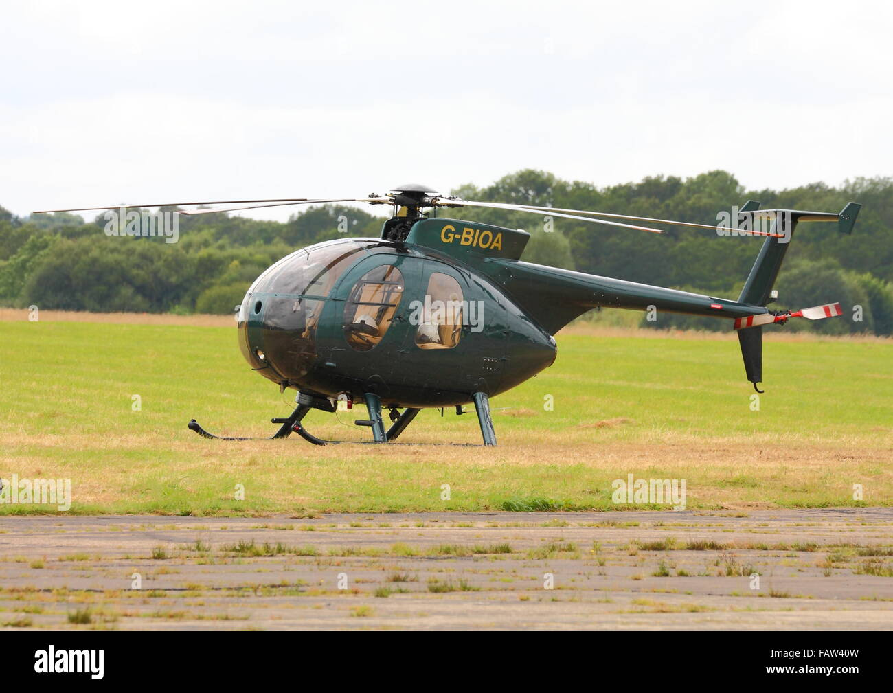 Hughes 369D helicopter at Dunsfold Aerodrome Surrey Stock Photo