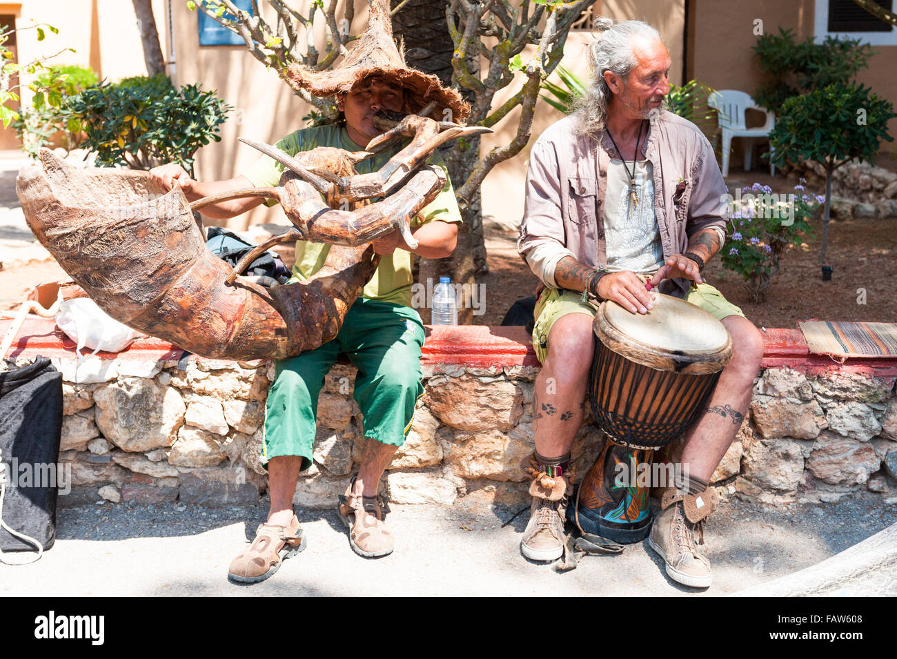 Two musicians entertain tourists at the old market in Ibiza, Balearic Islands,Spain - Stock Image