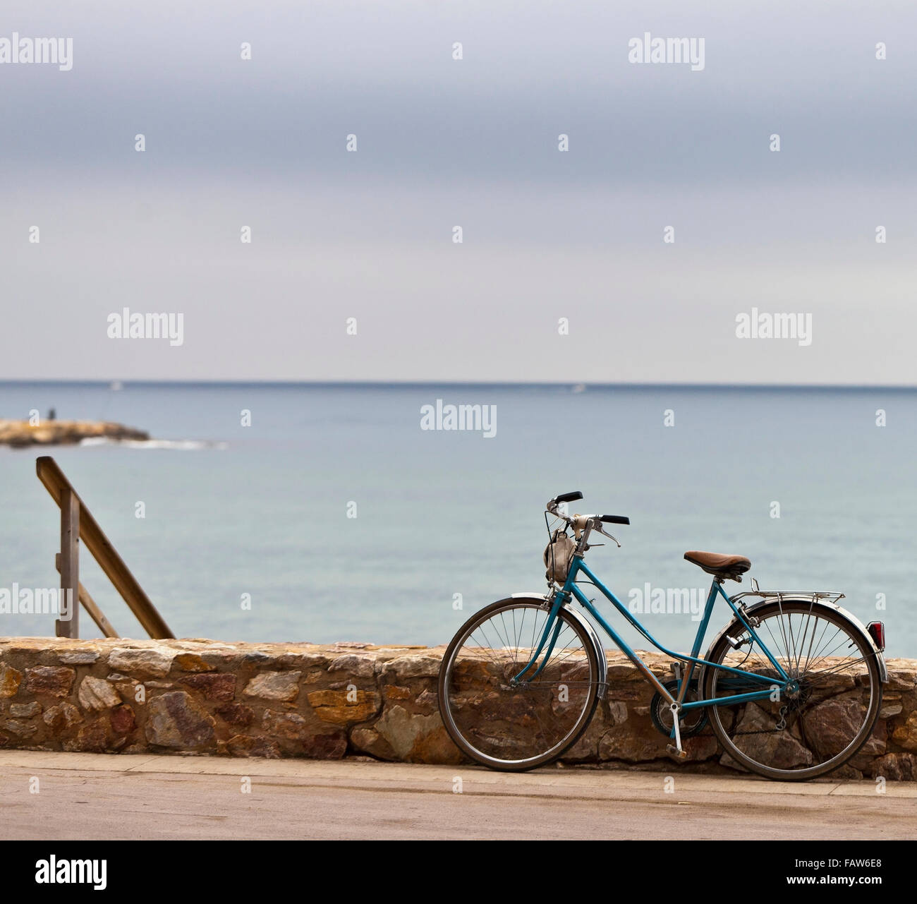 Vintage bike waiting for its owner  at the beach on a day with melancholic atmosphere - Stock Image