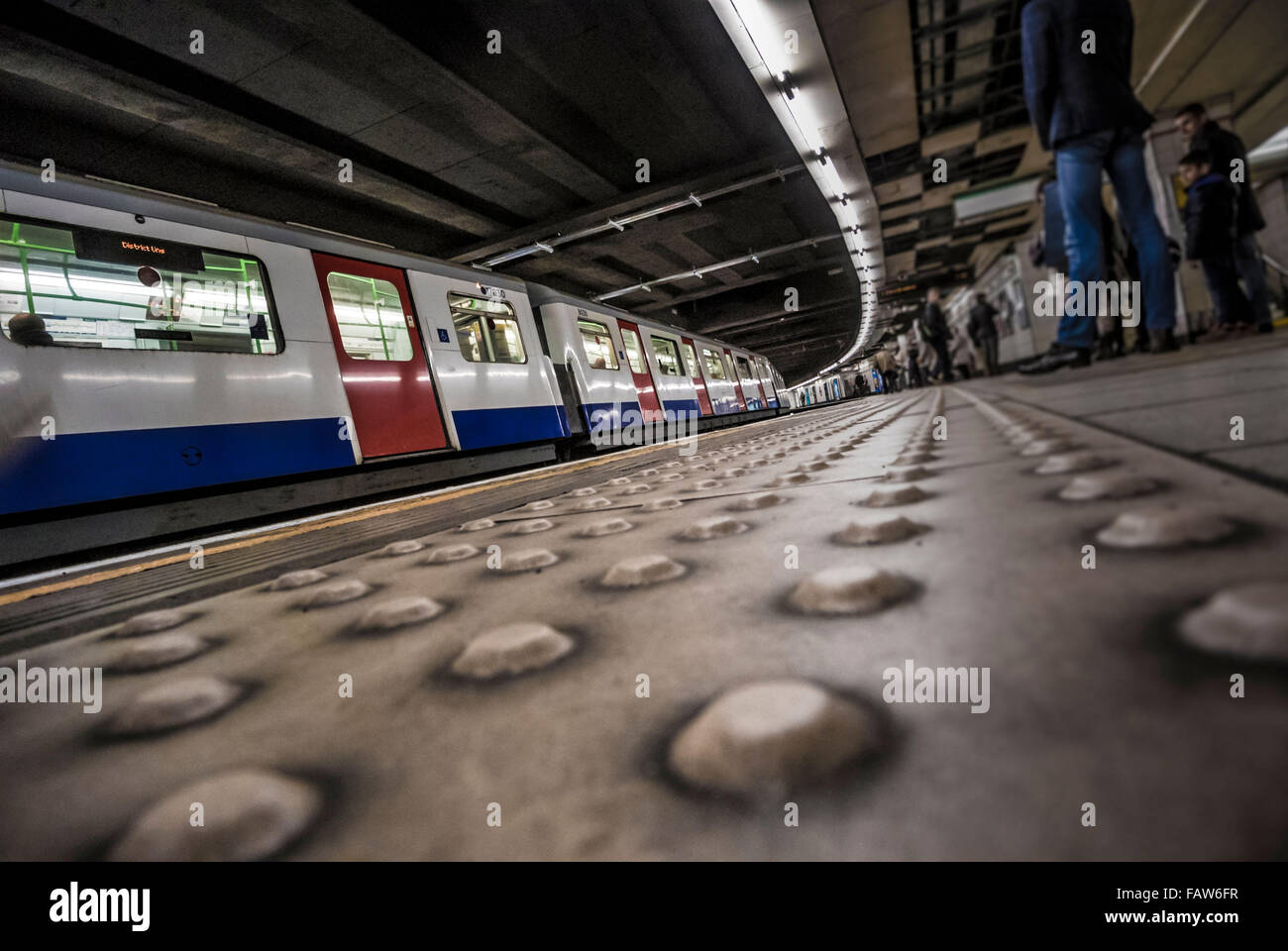 London underground station with tube train and platform - Stock Image