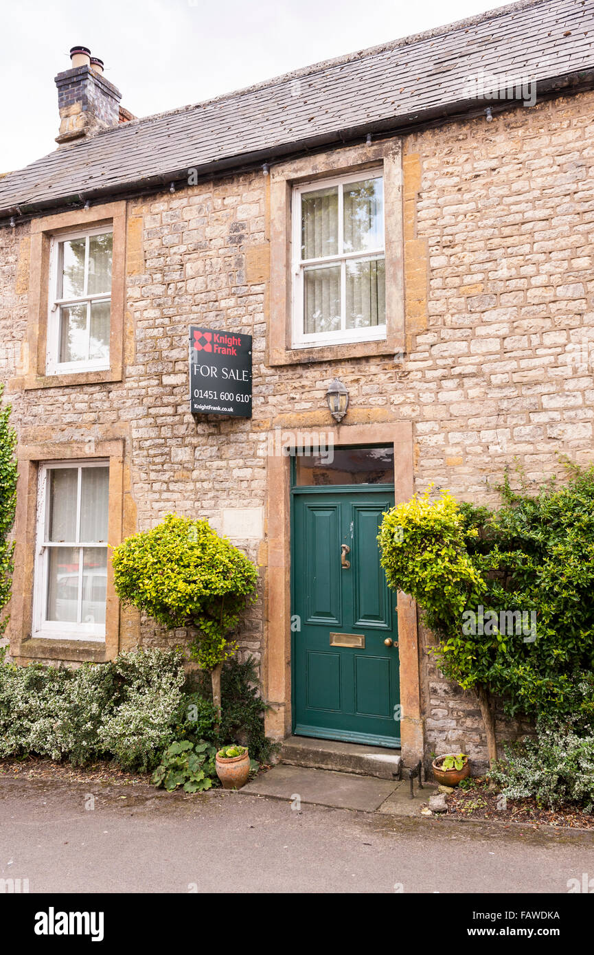 A Cotswold house for sale at Stow-on-the-Wold , Cheltenham , Gloucestershire , England , Britain , Uk - Stock Image