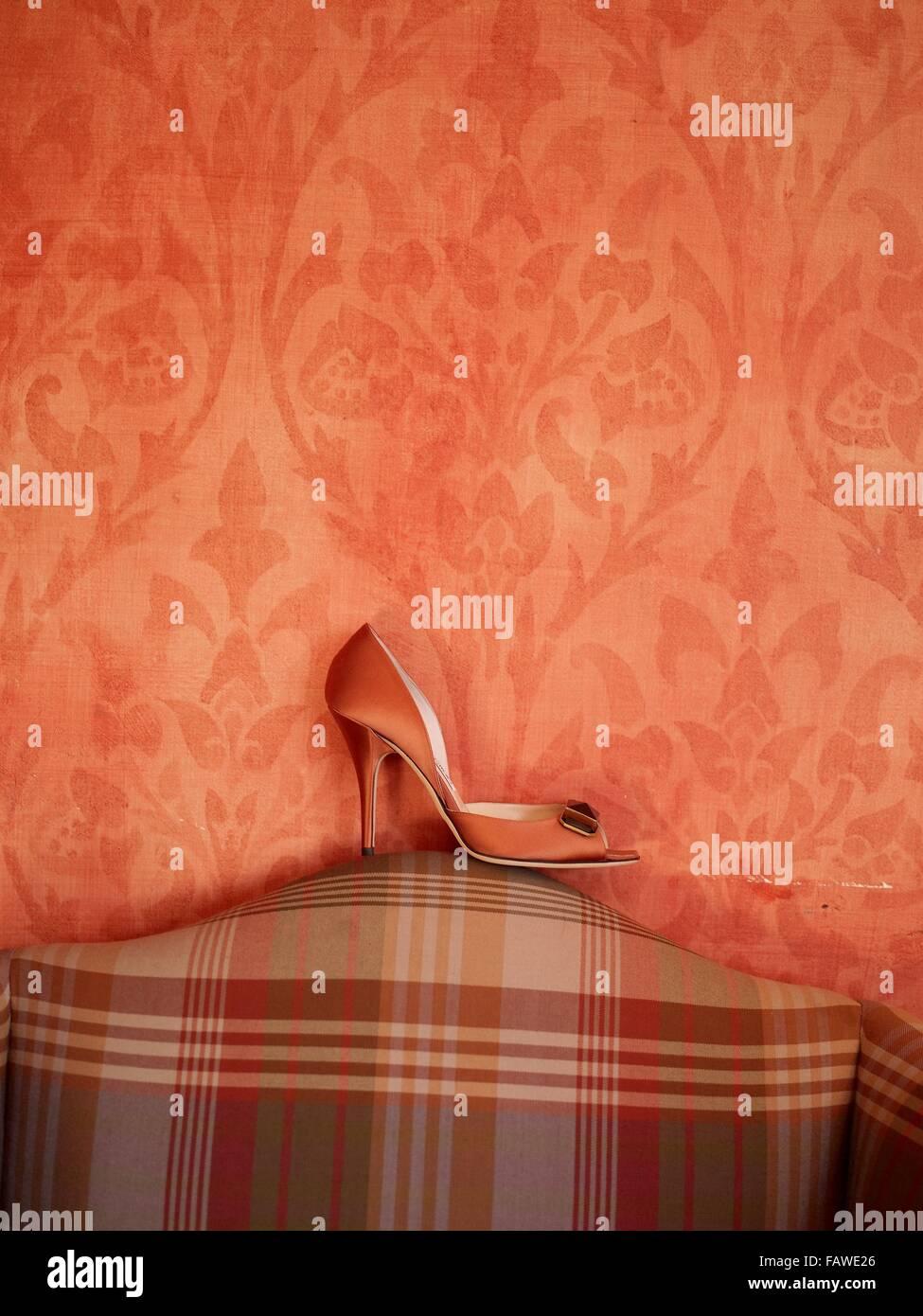 Orange wedding shoe - Stock Image